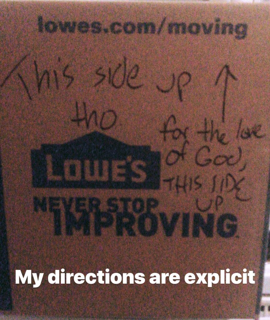 """A moving box with instructions, """"For the love of God, this side up!"""""""